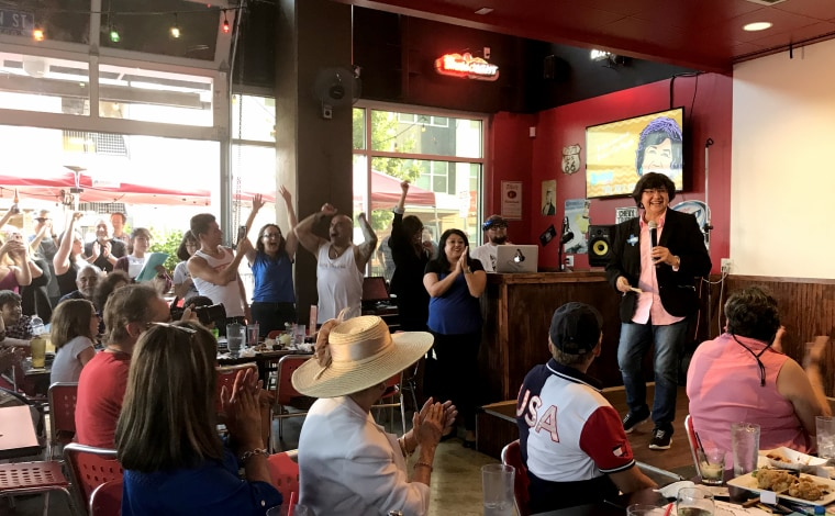 Lupe Valdez, Democrat candidate for Texas governor, is cheered by a people at her campaign event at Luther's Caf? in downtown San Antonio on Aug. 16, 2018.