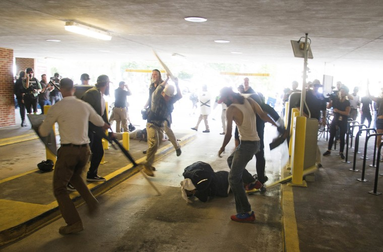 DeAndre Harris, bottom is assaulted in a parking garage beside the Charlottesville police station