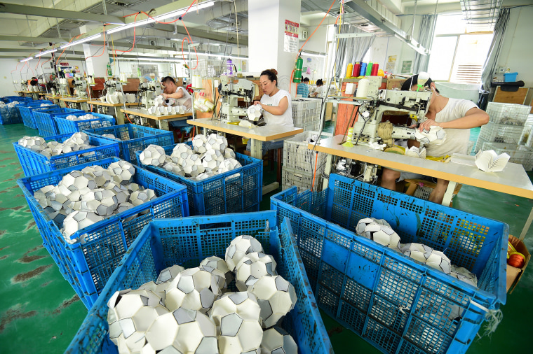 Workers Process Additional Football Orders From Overseas Customers In Yiwu
