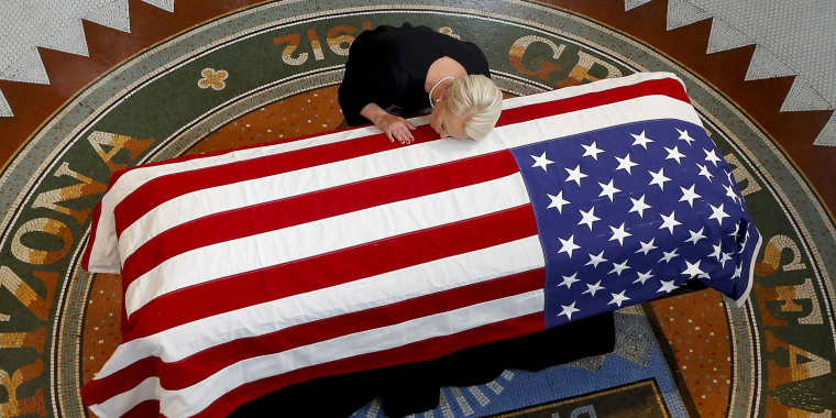 Image: Cindy McCain lays her head on casket of Sen. John McCain
