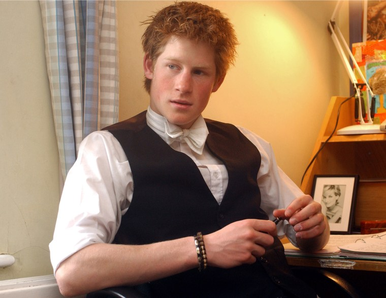 Prince Harry Sits At Desk