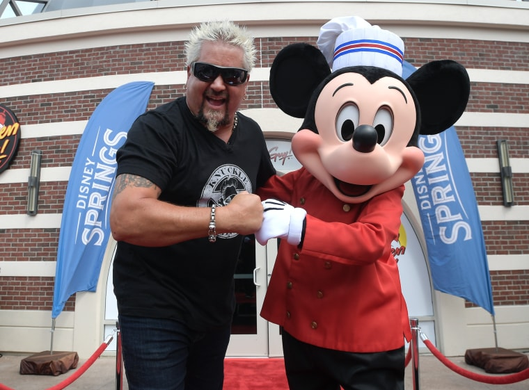 Chef Mickey Mouse made a special appearance at the opening of Fieri's new Disney Springs restaurant.