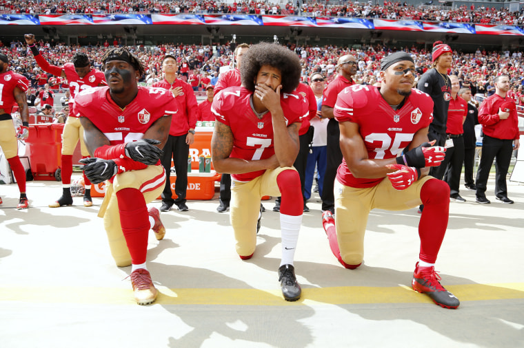 Image: Colin Kaepernick kneels during the national anthem