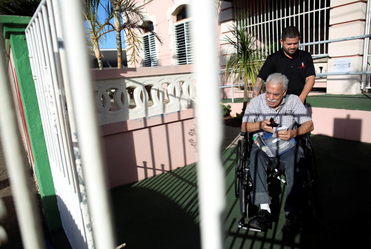 Image: Nicky Sanchez Quiles, a resident of the San Rafael nursing home and a dialysis patient, is taken to a hospital in Arecibo