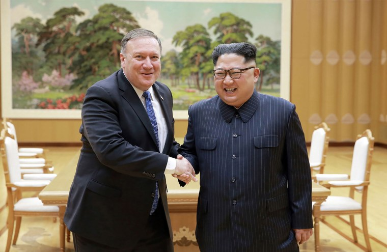 U.S. Secretary of State Mike Pompeo shakes hands with North Korean leader Kim Jong Un