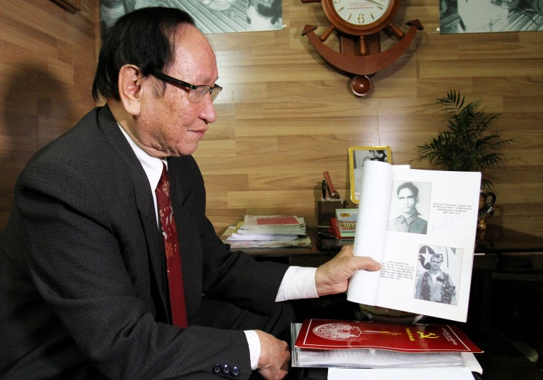 Tran Trong Duyet, the former director at the Hoa Lo prison in Hanoi, showing a photo at his home in Haiphong of US Senator John McCain