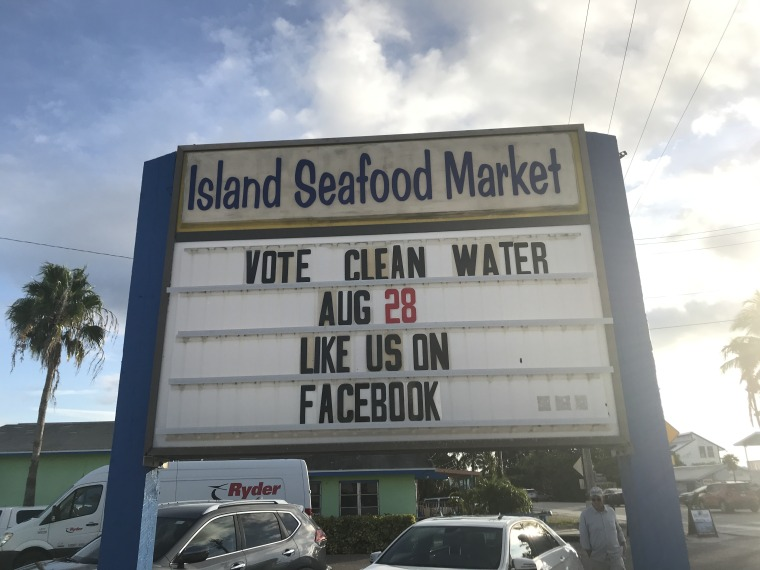 A sign outside the Island Seafood Market in Cape Coral, Florida urges voters to make clean water a ballot box priority in Sunshine State's August 28th primary.