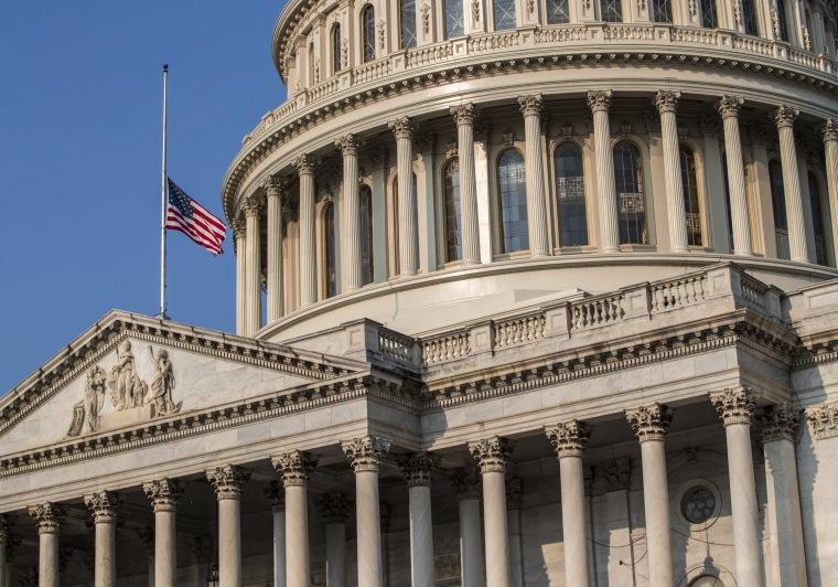 Image: The American flag flies at half-staff at the Capitol in honor of Sen. John McCain