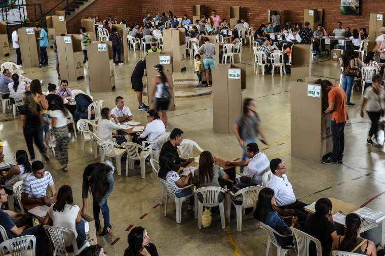 Image: People vote at a polling station in Medellin