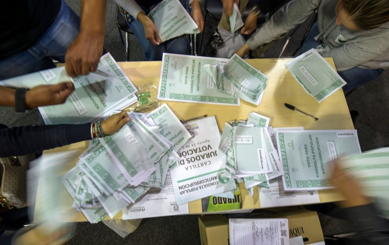 Image: Votes are counted at the end of a referendum in Bogota