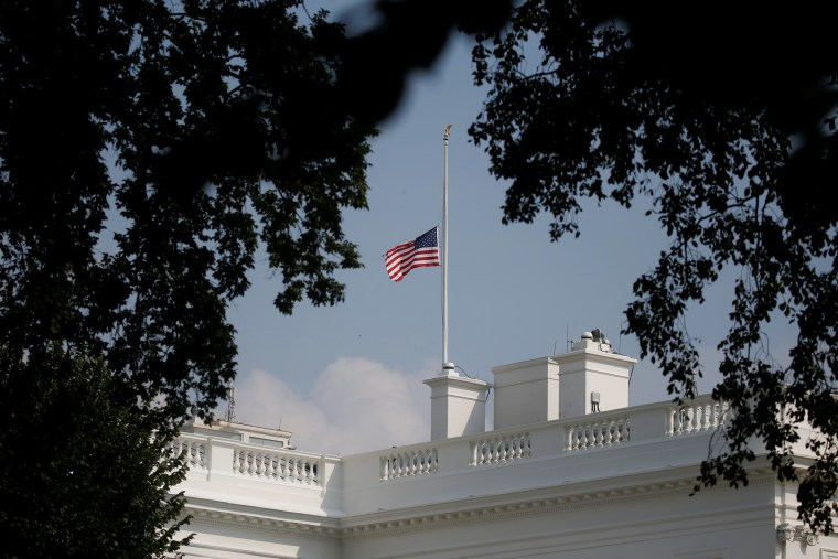 Image: White House flag once again flies at half-staff in honor of Senator John McCain (R-AZ) in Washington