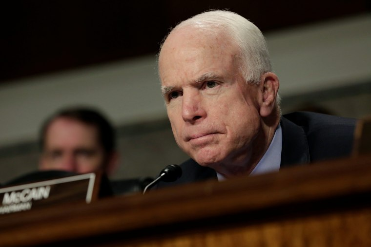 Image: Sen. John McCain attends the Senate Armed Services Committee hearing