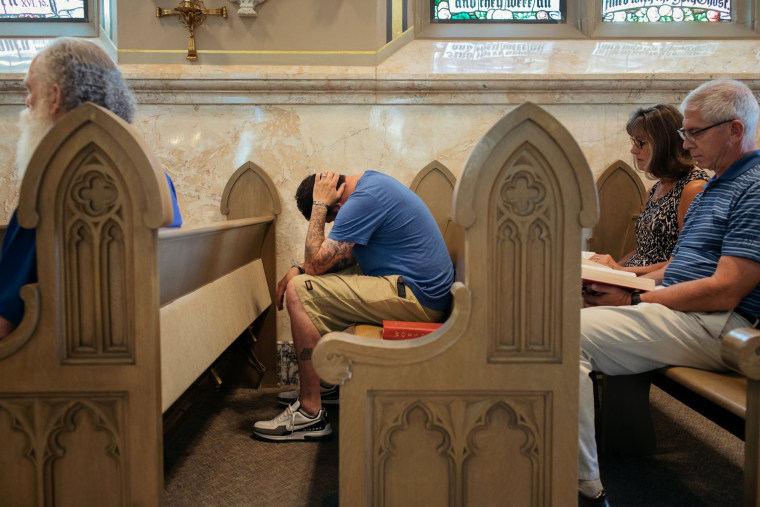 Image: Ryan Ranalli attends Mass at the Cathedral of St. Helena in Helena, Montana