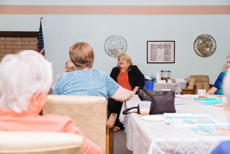 Image: Lesia Romanov speaks with guests during a meet-and-greet