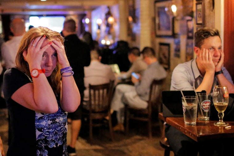 Image: People gathered in The Churchill Tavern, a British themed bar, react as the BBC predicts Britain will leave the European Union, in the Manhattan borough of New York