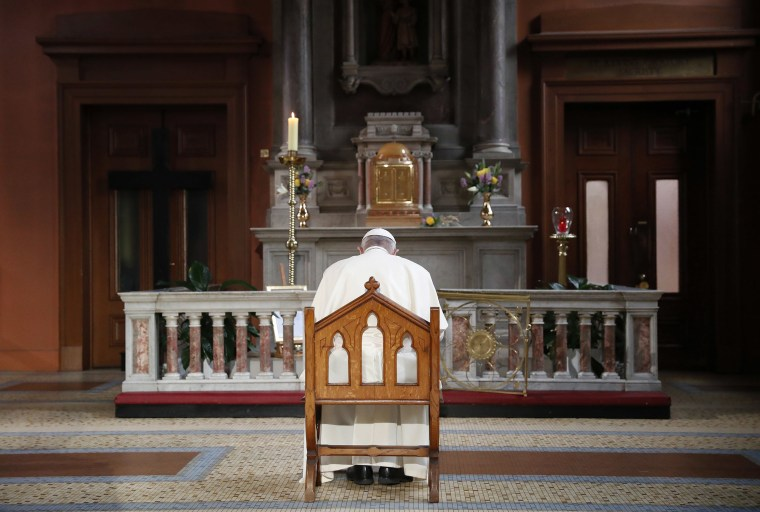Image: Pope Francis prays inside St Mary's Pro Cathedral