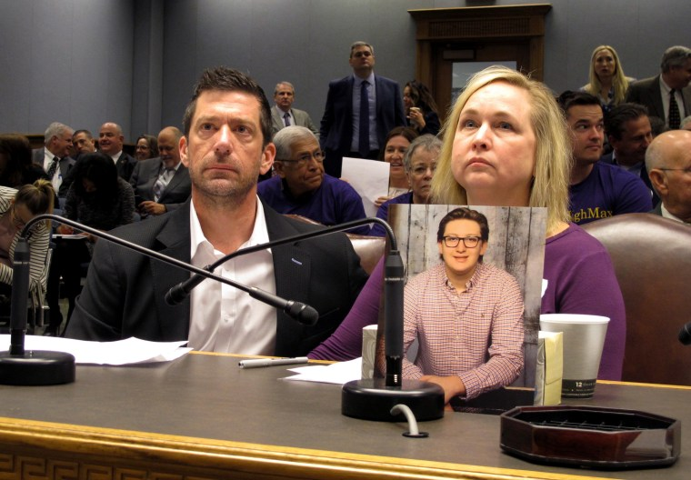 Stephen and Rae Ann Gruver sit in a House committee room