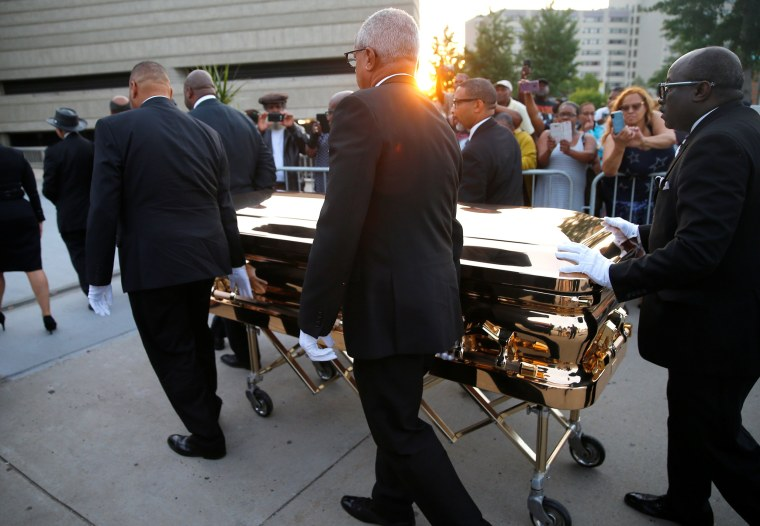 Image: Aretha Franklin's casket is carried into the Charles H. Wright Museum of African American History in Detroit
