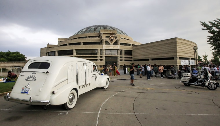 Image: Swanson Funeral Home's 1936 LaSalle hearse is parked outside the Charles H. Wright Museum of African American History