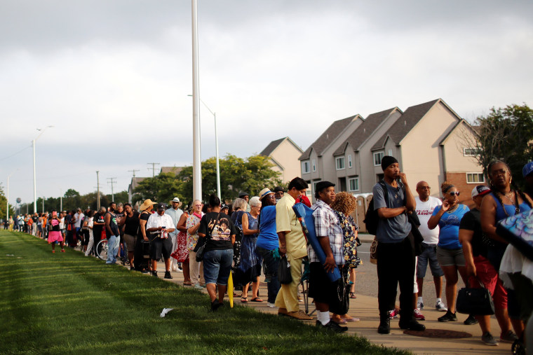 Image: People wait in line outside the Charles H. Wright Museum of African American History