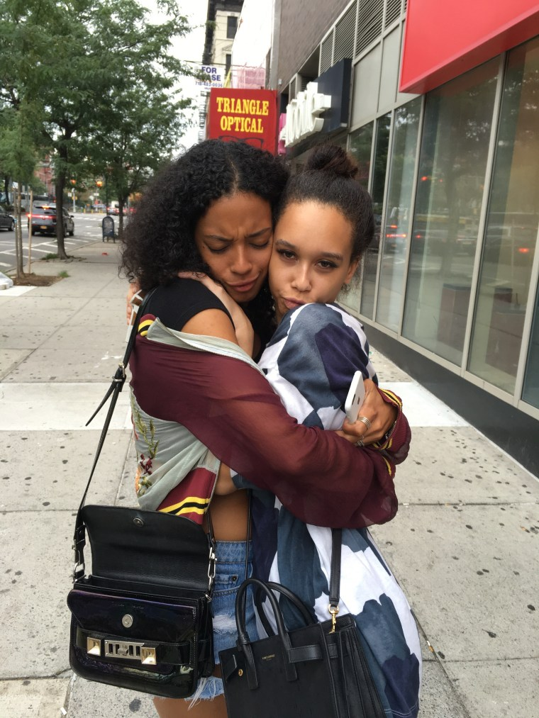 Lyric McHenry, left, hugs her younger sister, Maya McHenry.