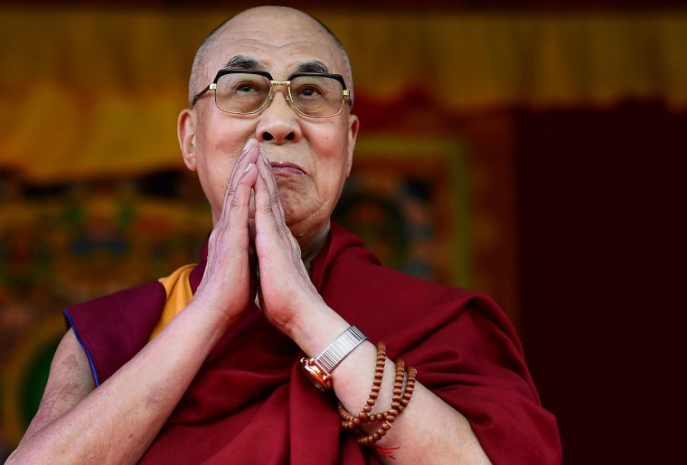 Image: The Dalai Lama taking to the stage to address the faithful in Aldershot