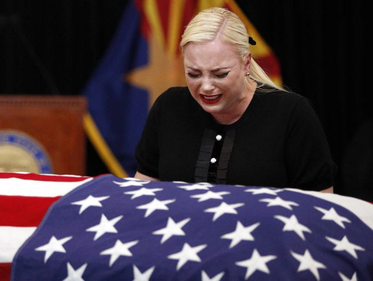 Image: Meghan McCain, daughter of Sen. John McCain, R-Ariz. cries at the casket of her father