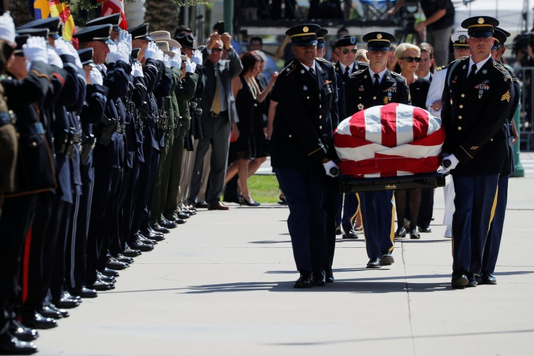 Image: Cindy McCain follows the casket of her late husband U.S. Senator John McCain into the Arizona State Capitol where he will lie in state in Phoenix