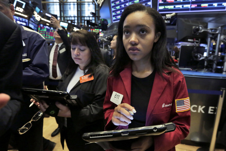 Traders Lauren Simmons, right, works on the floor of the New York Stock Exchange, Thursday, June 28, 2018.