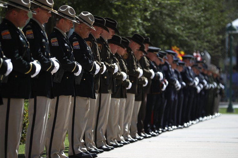 Image: Police honor guard stand in formation