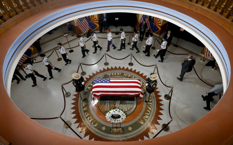 Image: Veterans walk past the casket of Sen. John McCain, R-Ariz.
