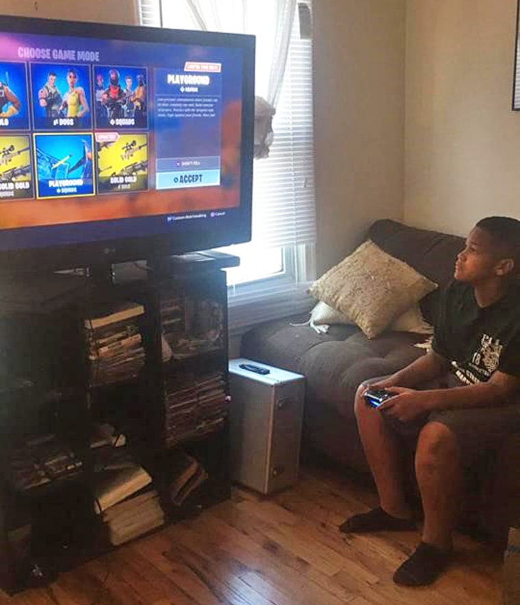 11-year-old Marcus Robert McElrath playing Fortnite at his home in Smryna, Delaware.