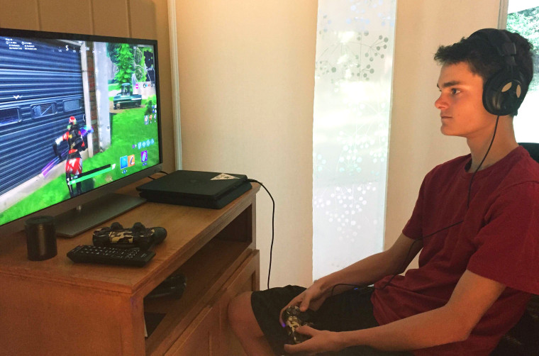 Wyatt Kosmerl, 14, playing Fortnite at his home in Avondale Estates, Georgia.