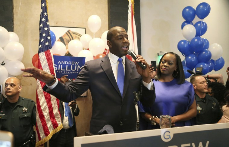 Image: Andrew Gillum, with his wife R. Jai Gillum at his side, addresses his supporters after winning the Democrat primary for governor