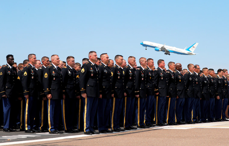 Image: The Arizona National Guard stands at attention as a military transport plane carrying the casket of Senator John McCain takes off on its way to Washington, DC in Phoenix