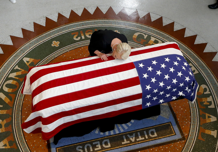 Image: Cindy McCain lays her head on casket of Sen. John McCain