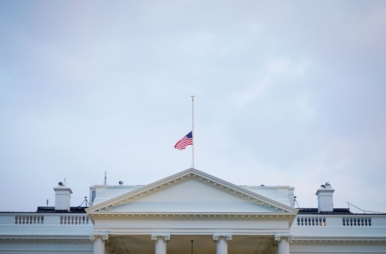 Image: A flag flies at half-staff above the White House
