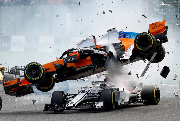Image: Fernando Alonso's McLaren flies through the air and lands on top of Charles Leclerc's Sauber