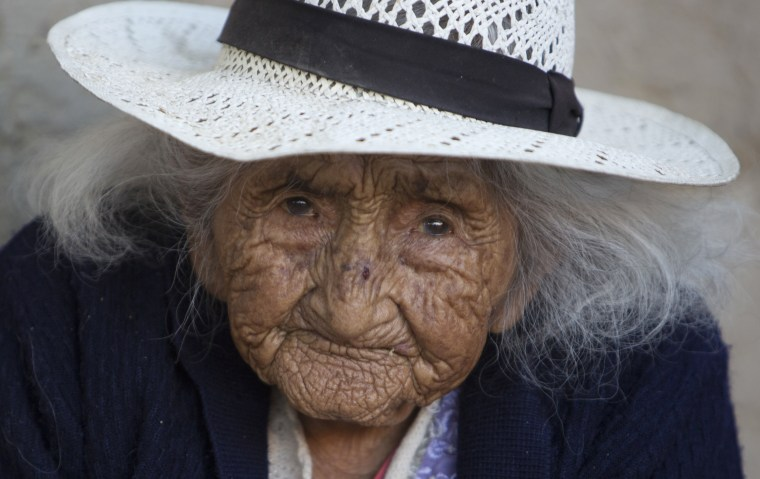 Image: 117-year-old Julia Flores Colque sits outside her home in Sacaba, Bolivia