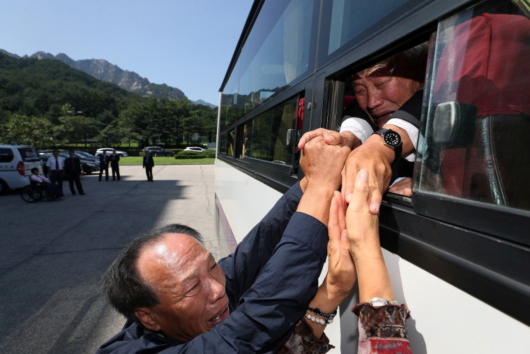 Image: North and South Korean separated family members bid farewell to each other on the last day of a reunion