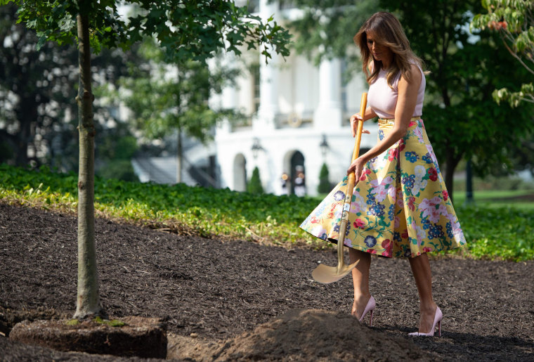 Image: First lady Melania Trump participates in a tree planting ceremony on the south grounds of the White House