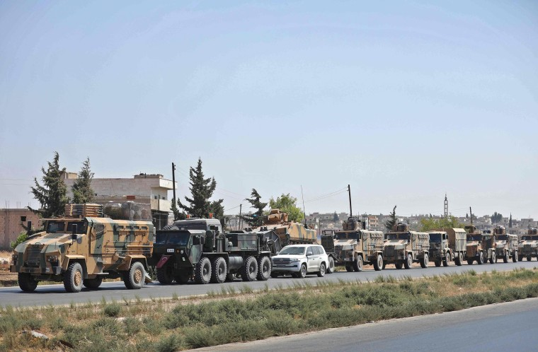 Image: Turkish forces move in a convoy in Syria's Idlib province