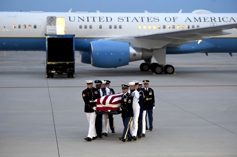 Image: Members of the military carry the flag-draped casket of the late US Senator John McCain