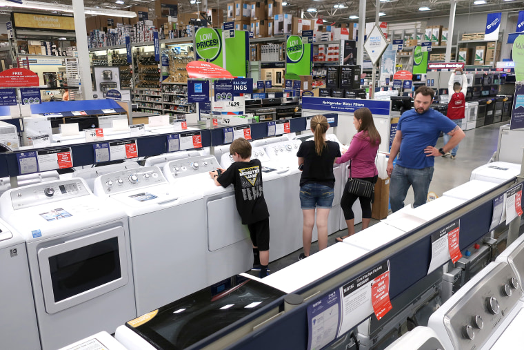 A family shops for washing and drying machines at Lowe's Home Improvement store in East Rutherford, New Jersey on May 21, 2018.
