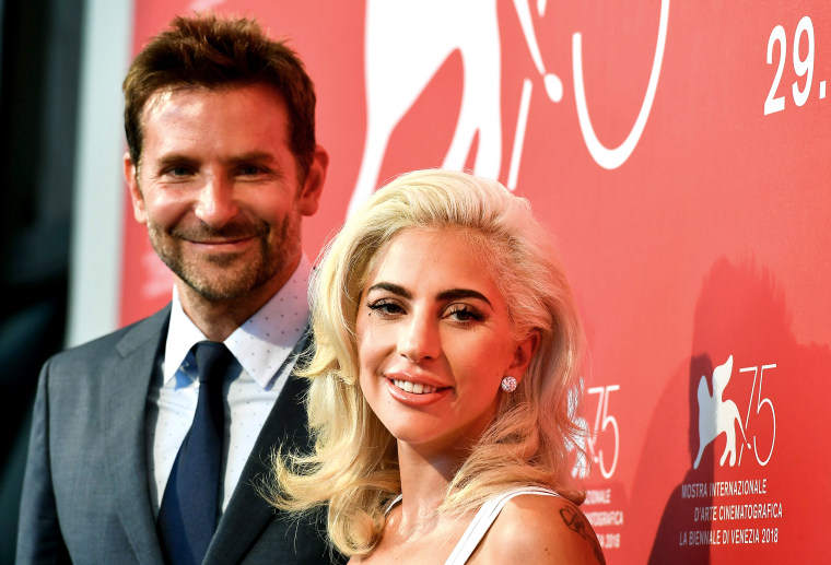 """Image: Singer and actress Lady Gaga and director and actor Bradley Cooper attend a photocall for the film """"A Star is Born"""""""