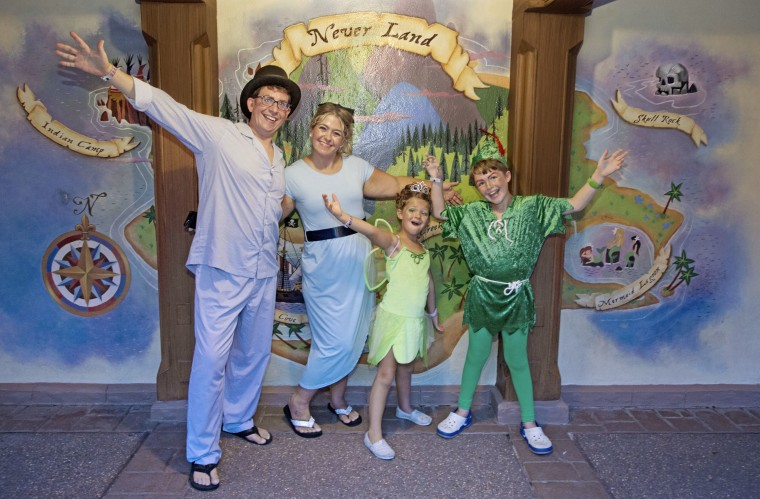 My Peter Pan crew, posing for a photo with WDW's Neverland Wall.