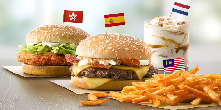 Flavors from Abroad / Taste of the World (left to right): Hong Kong's McSpicy Chicken Sandwich, Spain's Grand McExtreme Bacon Burger, Malaysia's BBQ McShaker Fries and Netherlands' Stroopwafel McFlurry.  Drive Thru Translite.