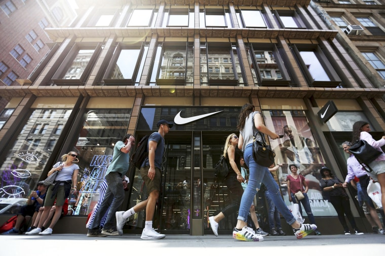 Image: People walk by the Nike SoHo store, June 15, 2017, in the SoHo neighborhood of New York.
