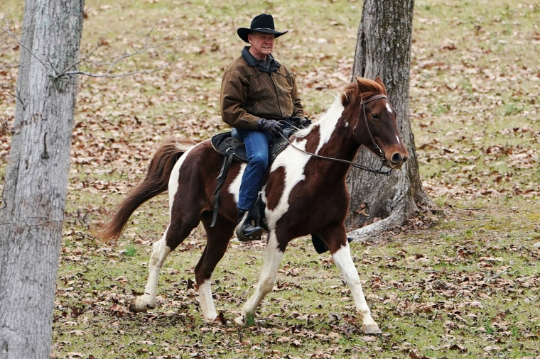Image: Republican Senate candidate Roy Moore arrives on his horse to cast his ballot in Gallant, Alabama