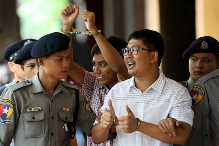 Image: Detained Reuters journalist Wa Lone and Kyaw Soe Oo arrive at Insein court in Yangon last month.